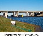 Big concrete river bridge with mooring post - stock photo
