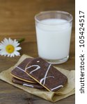 homemade cookies with chocolate and nuts and a glass of milk - stock photo