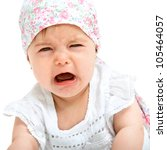 Close up Portrait of cute little girl crying. Isolated on white background. - stock photo
