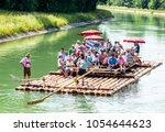 ISAR, GERMANY - JULY 10: typical bavarian raft ride on the river isar, a party with tradtional music on july 10, 2013 - stock photo