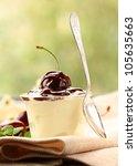 dessert  dairy with cherries and chocolate sauce - stock photo