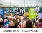 Aldermaston, United Kingdom, 1st April 2018:- CND protesters gather outside the main gate to the AWE where Britain's nuclear warheads are made, on the 60th anniversary of the first CND march in 1958 - stock photo