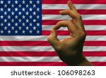 man showing excellence or ok gesture in front of complete wavy america national flag of  symbolizing best quality, positivity and success - stock photo