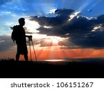 Silhouette of Hiker at the hike beginning with a sunset - stock photo