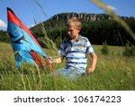 Teenage, Caucasian boy made kite on a mountain meadow - Table Mountains in Poland in village Pasterka - stock photo