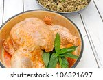 Raw chicken prepared with rice stuffing - stock photo