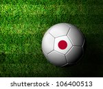 Japan Flag Pattern 3d rendering of a soccer ball in green grass - stock photo