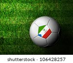 Equatorial Guinea Flag Pattern 3d rendering of a soccer ball in green grass - stock photo