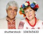 portrait of an elderly couple in Ukrainian costumes - stock photo