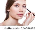 natural woman with eye pencil on white background - stock photo
