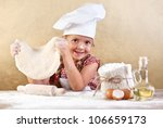 Little girl making pizza or pasta dough smeary with flour - stock photo