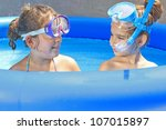 Girls in the swimming pool - stock photo