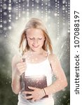 Happy Young Girl Opening a Gift Box - stock photo
