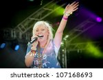 YATELEY, UK - JUNE 30: British pop star Alexa Goddard performing at the GOTG Festival in her home town of Yateley, UK on June 30, 2012 - stock photo