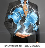 Business people holding glass phone with global business concept - stock photo
