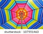 Beach umbrella on a summer day - stock photo