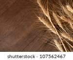 golden wheat on the old wooden background - stock photo