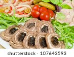 Cutting meat tenderloin with prune with lettuce, tomatoes and Ruccola - stock photo