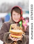 Young woman with pancake during  Shrovetide at Russia - stock photo