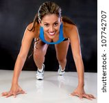 Female athlete in a position ready to run - stock photo