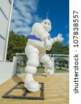 GOODWOOD, UK - JULY 1: Bibendum, more commonly known as the Michelin Man - advertising symbol of the Michelin motor company, on display at Goodwood, UK on July 1, 2012 - stock photo
