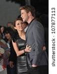 "LOS ANGELES, CA - MARCH 25, 2010: Miley Cyrus & Liam Hemsworth at the world premiere of their new movie ""The Last Song"" at the Arclight Theatre, Hollywood. - stock photo"