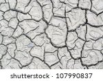 abstract dry muddy and fissured ground - stock photo