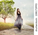 Beautiful Young Girl at a Magical River - stock photo