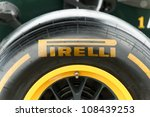 FARNBOROUGH, UK - JULY 15: Closeup of a Pirelli tyre attached to a Caterham Formula 1 race car on static display at the Farnborough Airshow, UK on July 15, 2012 - stock photo