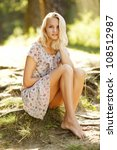 young beautiful girl in summer forest - stock photo