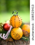 Christmas time, oranges with cloves - stock photo