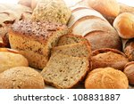 Composition with loafs of bread and rolls - stock photo