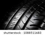 Close up view of a car tyre isolated on a black background - stock photo