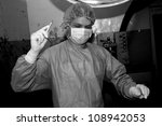 Shaded surgeon prepare cut before coming difficult surgery - stock photo