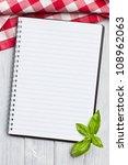 blank recipe book on kitchen table - stock photo