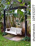 wood swing in garden - stock photo