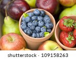 summer or autumn fresh fruit including: blueberries, strawberries, apples and pears - stock photo