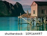 Old fishing port by the fjord on Lofoten islands in Norway - stock photo