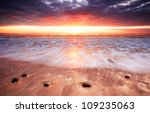 Glorious Sunset lights up the surf - stock photo