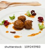 white plate with  beef meatballs and sauce - stock photo