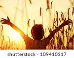 Kid at wheat field - stock photo