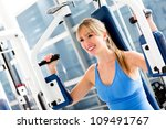 Beautiful fit woman exercising at the gym - stock photo