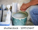 Man shaping marble using a lathe in a workshop in Turkey 27 June 2008 - stock photo