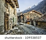 traditional stone houses in Italy Alps - stock photo
