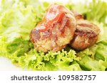 A juicy steak with lettuce and tomato sauce - stock photo