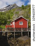Typical norwegian rorbu hut in traditional village of Nusfjord on Lofoten islands - stock photo