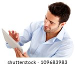 Businessman using a tablet computer - isolated over a white background - stock photo