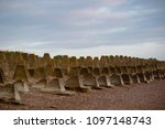 Coastal defences on the Isle of Grain, Kent United Kingdom from World War 2 to defend against a Nazi invasion of Britain - stock photo