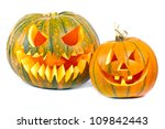 Halloween pumpkins with scary face over white background - stock photo