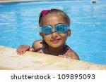 Girl in the swiimming pool - stock photo